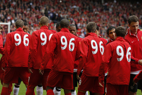 Liverpool and Manchester United players shake hands before their English Premier League soccer match (Reuters)