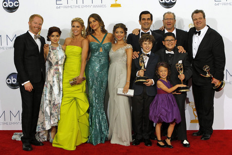The cast and crew of Modern Family, winner of the award for outstanding comedy series, pose backstage at the 64th Primetime Emmy Awards in Los Angeles (Reuters/Mario Anzuoni)