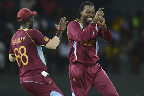 West Indies' Chris Gayle, right, performs a dance (perhaps rain?) as team mate Darren Sammy runs to join him (Reuters)