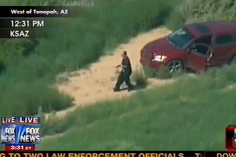 A still from the broadcast shows the man fleeing from the vehicle