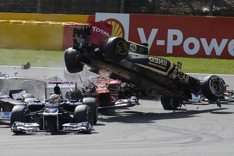 Lotus Formula One driver Romain Grosjean of France crashes at the start of the Belgian F1 Grand Prix (Reuters)
