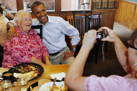 US President Barack Obama poses for a photo at The Buff restaurant (Reuters)