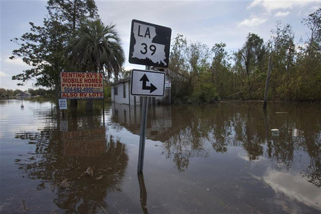 A road sign sticks out above floodwater in the aftermath of Hurricane Isaac (Reuters)