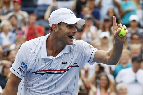 Andy Roddick of the U.S. gestures to his box after defeating Fabio Fognini of Italy during their men's singles match at the U.S. Open tennis tournament in New York (Reuters/Eduardo Munoz)