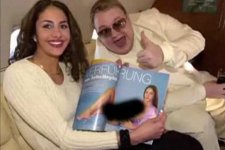 Kim Dotcom posing with a men's magazine model
