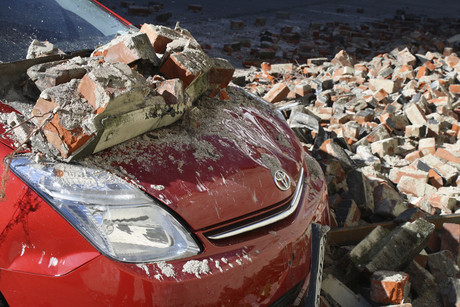 A quake-damaged car is pictured in Christchurch on September 4, 2010 (Reuters)