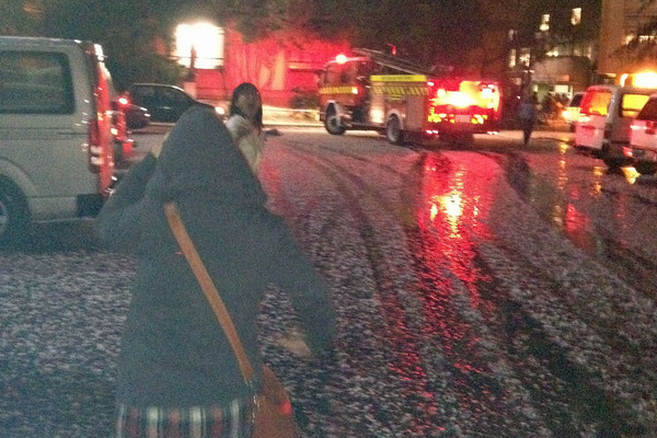Hail is seen on the ground as students evacuate the University of Canterbury (Photo: Pip Wid)