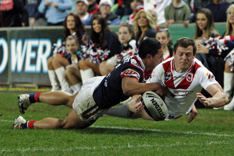 Roger Tuivasa Sheck saves a try by Brett Morris during the NRL round 22, Sydney Roosters v St George Illawarra Dragons (NZN)