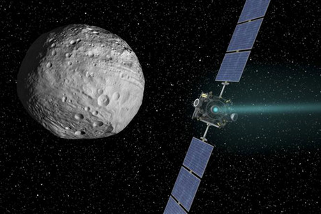 NASA's Dawn spacecraft with Vesta (NASA artwork)