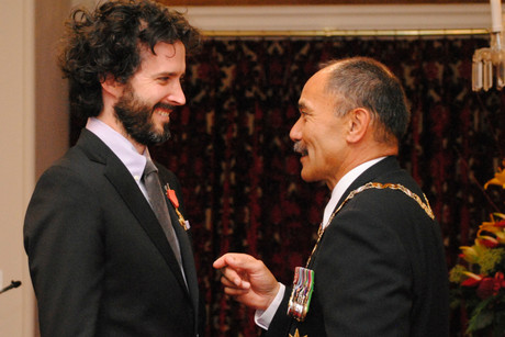 Bret McKenzie receiving his New Zealand Order of Merit medal (Photo: Government House)