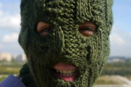 A masked Pussy Riot fan in the video message to supporters