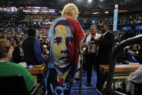 A delegate wears a dress bearing likeness of President Obama (Reuters)