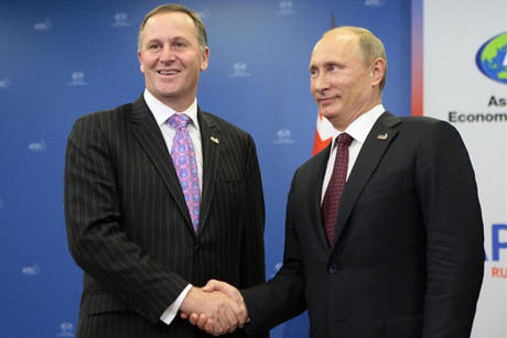 John Key with Vladimir Putin during a meeting at APEC (Reuters)