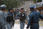 Afghan police arrive at the site of the attack  (Reuters)