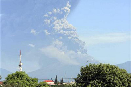 Large clouds of gas and ash being thrown from the volcano  (Reuters)