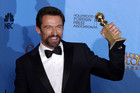 Hugh Jackman holding his award (AAP)