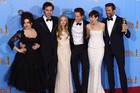 The cast of Les Miserables with their Golden Globe trophy (AAP)