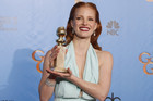 Jessica Chastain holds her Golden Globe trophy (Reuters)