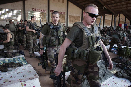 French soldiers leave a hangar at the Malian army air base in Bamako (Reuters)