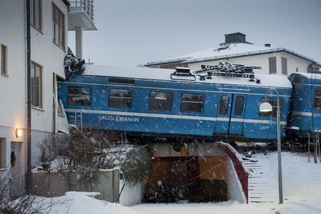 The train derailed, crashing into an apartment block (Reuters)