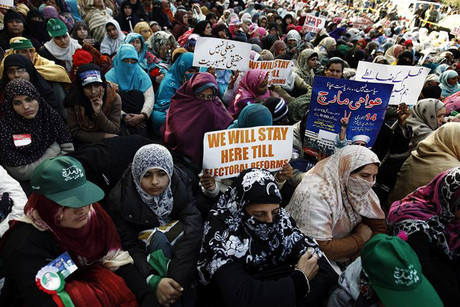 Supporters of Sufi cleric Muhammad Tahir-ul-Qadri listen to him speak on the second day of protests in Islamabad (Reuters)