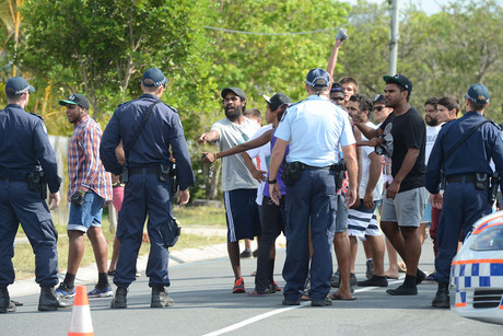 Aboriginal men confront police after Pacific Islander men were seen in Douglas Street in Woodridge south of Brisbane (AAP)