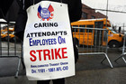 A New York City bus driver stands on strike outside a bus depot in the Queens borough of New York (Reuters)