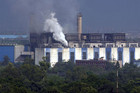 Smoke billows from the chimneys of a power station in New Delhi (Reuters)