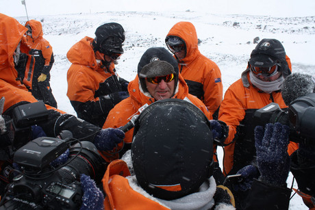 Prime Minister John Key speak to the media at the wind farm above Scott Base, Antarctica (AAP)