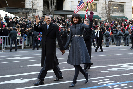 US President Barack Obama and first lady Michelle Obama walk after emerging from the presidential limousine during the inaugural parade (Reuters)