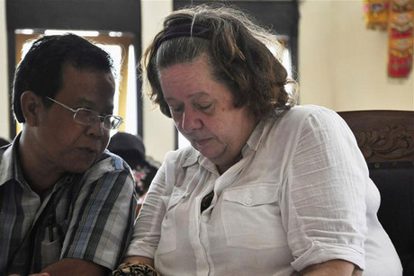 Lindsay Sandiford with her translator during her trial today (Reuters)