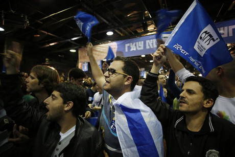 Supporters of Prime Minister Benjamin Netanyahu's Likud party celebrate at the party's headquarters in Tel Aviv (Reuters)