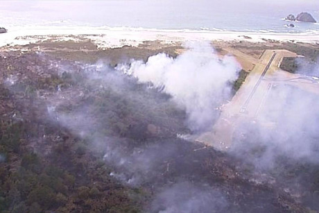 The fire spread across 112 hectares of native bush and pine forests