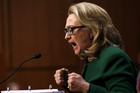 US Secretary of State Hillary Clinton pounds her fists while testifying on the Benghazi attacks (Reuters)