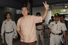 Somyot Pruksakasemsuk arrives at court in Bangkok (Reuters)