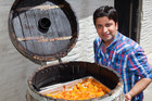 Chef Kunal Kapur with a barrel of stewed apricots in Central Otago (Photo: Supplied)