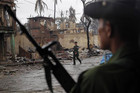 Soldiers patrol through a neighbourhood in Sittwe (file, Reuters)