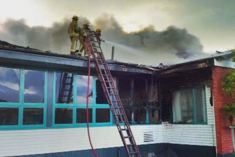 Fire fighters battle the blaze at the school