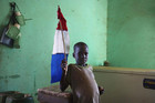 A boy holds a homemade French flag in the recently liberated town of Douentza, Mali (Reuters)
