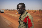 A Malian soldier smokes a cigarette in the recently liberated town of Douentza (Reuters)