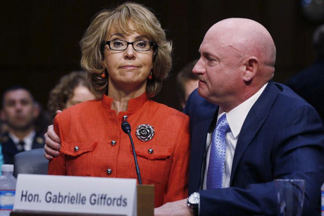 Gabrielle Giffords (L) with her husband Capt Mark Kelly at the gun control hearing (Reuters)
