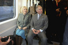 Prince Charles (R) and his wife Camilla on the Metropolitan line train (Reuters)