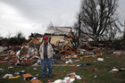 James Heard surveys the damage to a neighbor's home which was destroyed after a tornado hit in Adairsville, Georgia (Reuters)