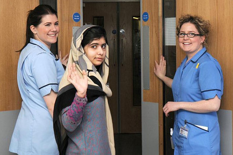 Malala Yousufzai waves as she is discharged from The Queen Elizabeth Hospital  (Reuters)