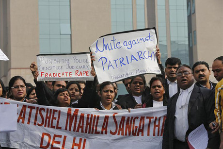 Lawyers shout slogans at a protest against rape outside a court in New Delhi  (Reuters)