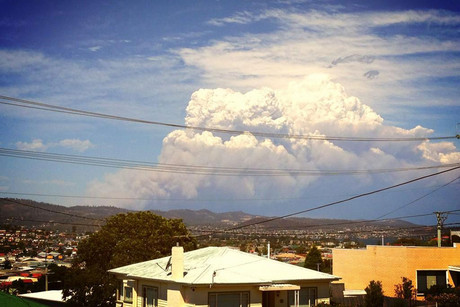 Supplied image of a smoke plume from a fire seen from West Moonah in Hobart, Tasmania (AAP)