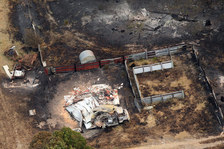 Homes damaged by a bushfire are seen from a helicopter between Dunalley and Boomer Bay, Tasmania (AAP)