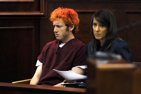 Colorado shooting suspect James Holmes with a lawyer during his first court appearance in July 2012 (Reuters file)