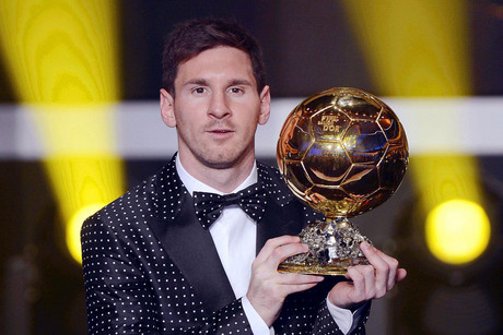 Lionel Messi accepts his award (AAP)
