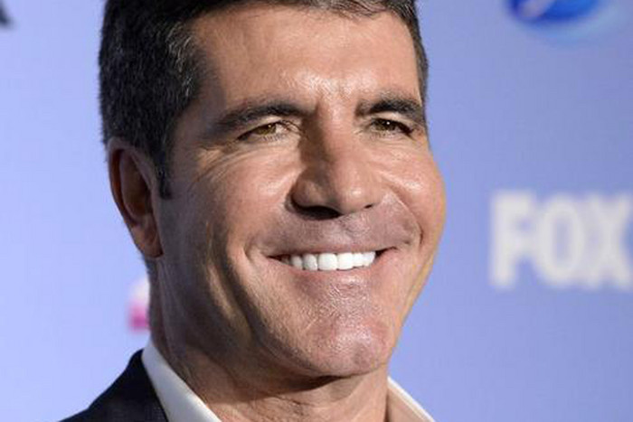 Simon Cowell hires dog therapist